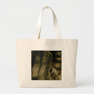 gray edge of rock face large tote bag