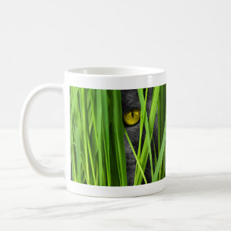 Gray Yellow Eyed Cat Hiding in the Grass Coffee Mug