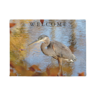 Great Blue Heron framed with fall foliage Doormat