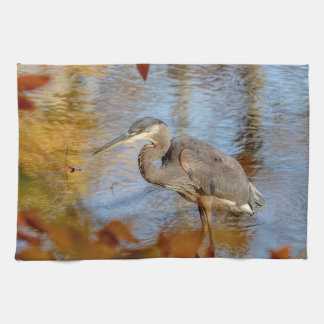 Great Blue Heron framed with fall foliage Kitchen Towel