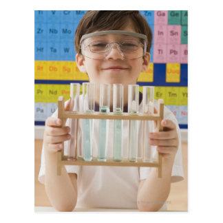 Greek boy holding rack of test tubes post cards