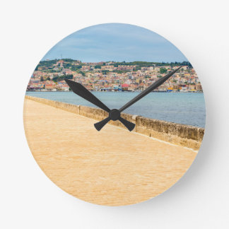 Greek City Port Argostoli with road on bridge Round Clock