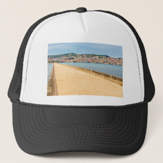 Greek City Port Argostoli with road on bridge Trucker Hat