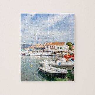 Greek harbor with sailing boats in Fiskardo Jigsaw Puzzle