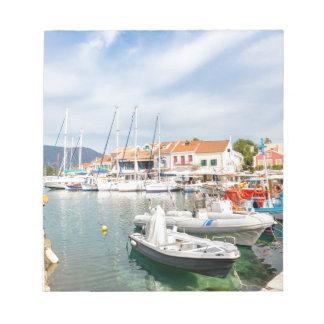 Greek harbor with sailing boats in Fiskardo Notepad