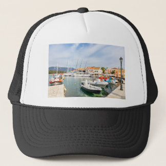 Greek harbor with sailing boats in Fiskardo Trucker Hat