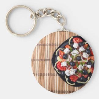 Greek vegetarian salad of tomatoes, cucumbers, oni basic round button keychain
