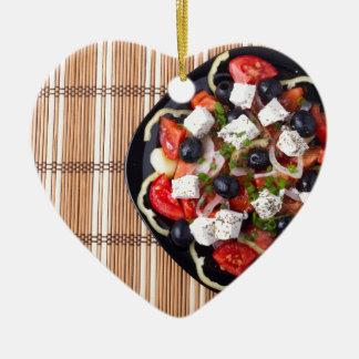 Greek vegetarian salad of tomatoes, cucumbers, oni ceramic heart ornament