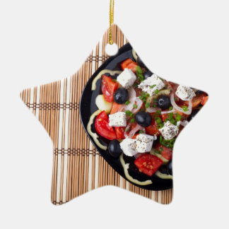Greek vegetarian salad of tomatoes, cucumbers, oni ceramic star ornament