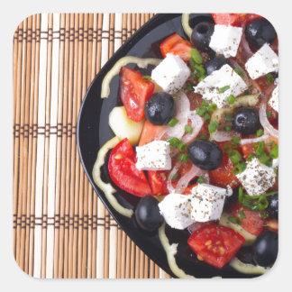 Greek vegetarian salad of tomatoes, cucumbers, oni square sticker