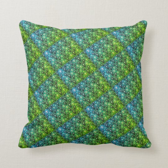 green and blue design pillow