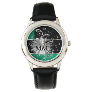 Green  and silver monogram on black watch