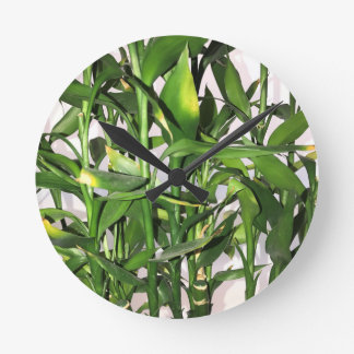 Green bamboo shoots and leaves round clock