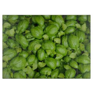 Green basil leaves cutting board
