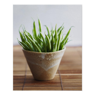 Green beans in pot on bamboo surface poster