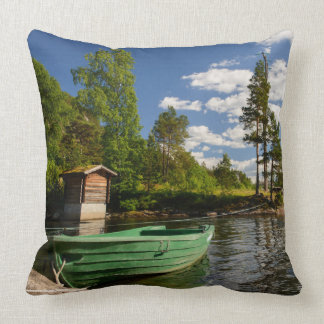 Green boat in a fjord in Norway Throw Pillow