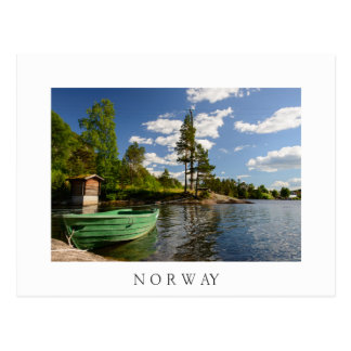 Green boat in a fjord in Norway white postcard