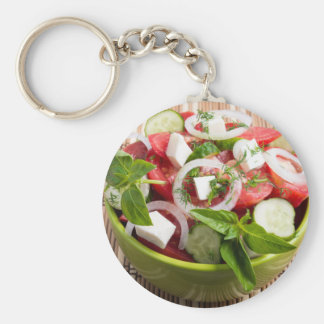 Green bowl with tasty and wholesome vegetarian basic round button keychain