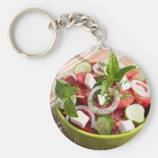 Green bowl with tasty and wholesome vegetarian keychain