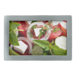 Green bowl with tasty and wholesome vegetarian rectangular belt buckles