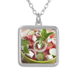 Green bowl with tasty and wholesome vegetarian silver plated necklace
