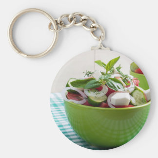 Green bowl with vegetable salad on tablecloth basic round button keychain