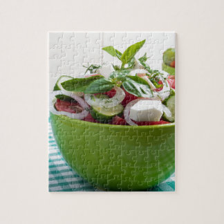 Green bowl with vegetable salad on tablecloth jigsaw puzzle