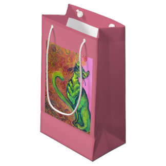green cat on pink gift bag