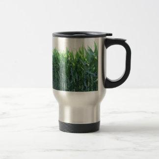 Green corn field on summer day travel mug