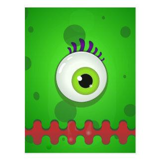 Green cyclops monster with a huge eye postcard