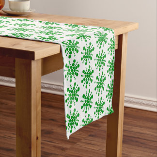 Green dotted stars on white short table runner