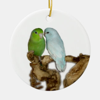 Green female parrotlet with blue dilute male ceramic ornament
