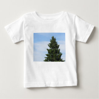 Green fir tree against a clear sky baby T-Shirt