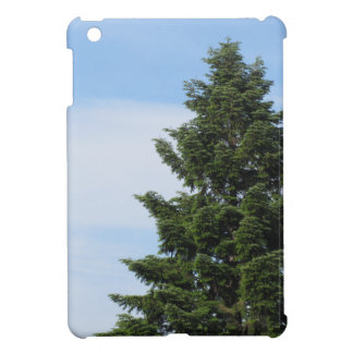 Green fir tree against a clear sky iPad mini case