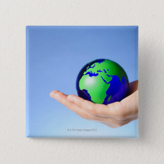 Green globe in hand 2 inch square button