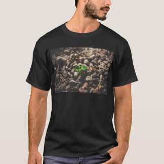 Green Leafy Plant Starting to Grow on Beige Racks T-Shirt