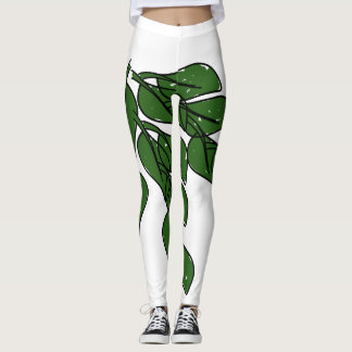 Green leaves artwork on white leggings