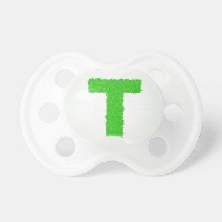 green letter pacifier