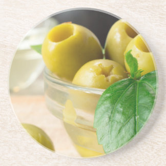 Green marinated olives pitted adorned with green beverage coaster