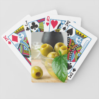 Green marinated olives pitted adorned with green bicycle playing cards