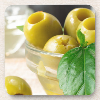 Green marinated olives pitted adorned with green coasters