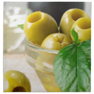 Green marinated olives pitted adorned with green napkin