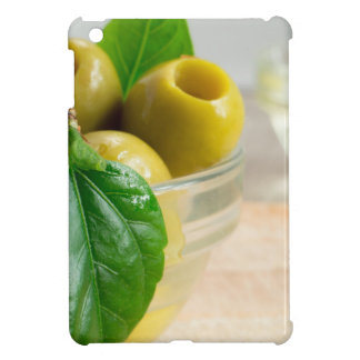 Green marinated olives pitted in a glass cup cover for the iPad mini