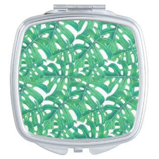 Green monstera tropical leaves pattern  on white b travel mirror