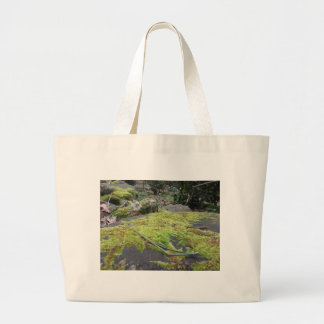 Green moss in nature Detail of moss covered stone Large Tote Bag