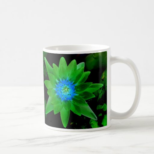 green neat water lily flower against green leaves coffee mugs