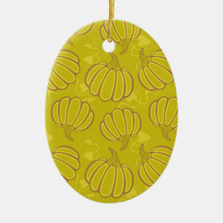 Green pattern with pumpkins ceramic oval ornament