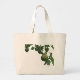Green pears hanging on a growing pear tree large tote bag
