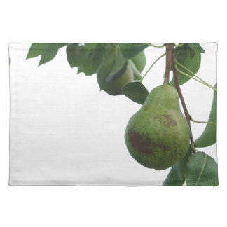 Green pears hanging on a growing pear tree placemat
