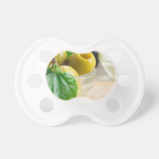 Green pickled pitted olives closeup pacifier